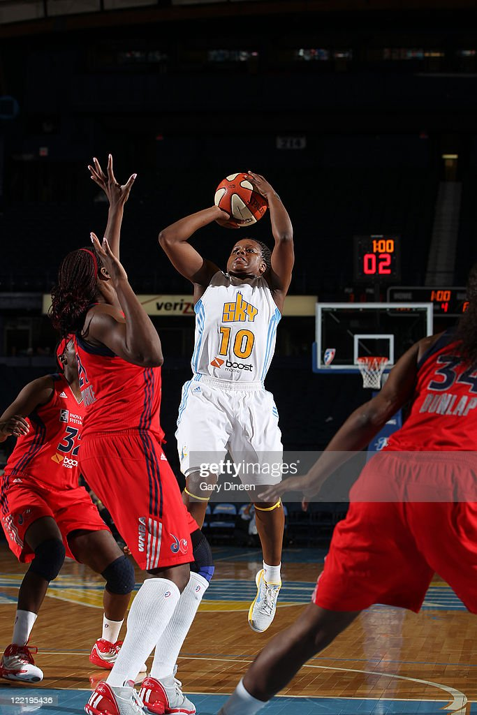 Epiphanny Prince of the Chicago Sky put up a shot over Nicky Anosike of the Washington Mystics during the WNBA game on August 26 2011 at the AllState...