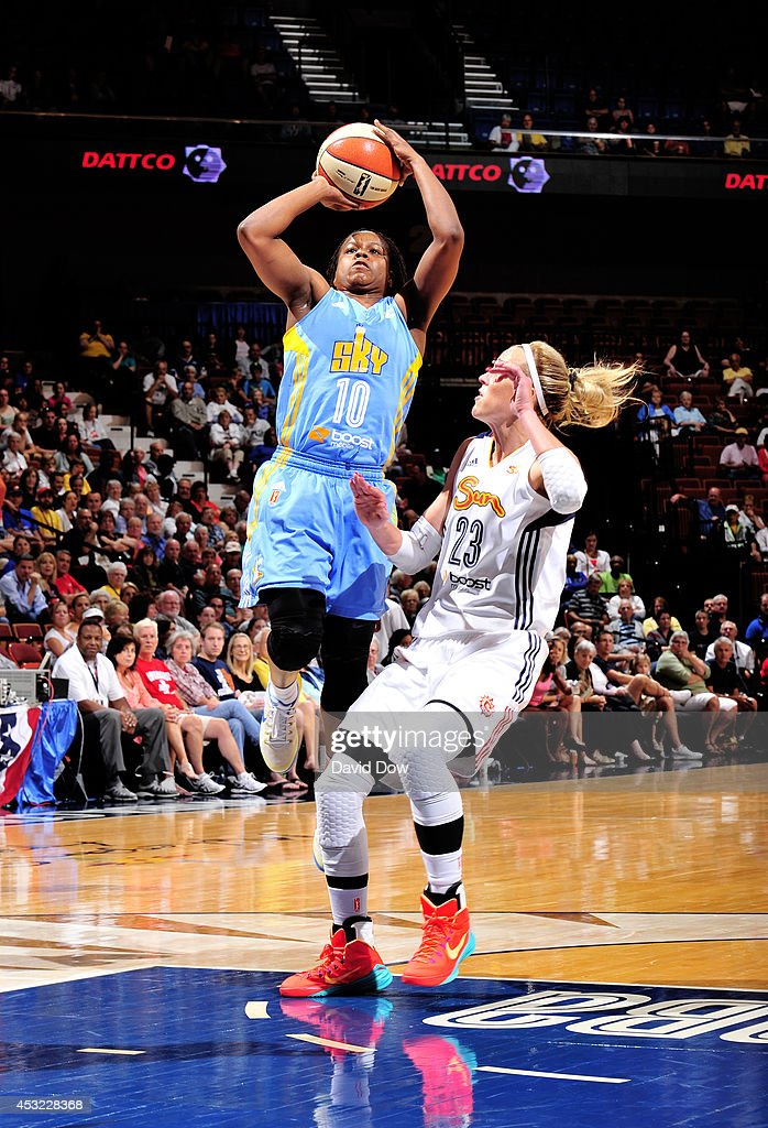 Epiphanny Prince of the Chicago Sky shoots the basketball against Katie Douglas of the Connecticut Sun on August 5 2014 at the Mohegan Sun Arena in...