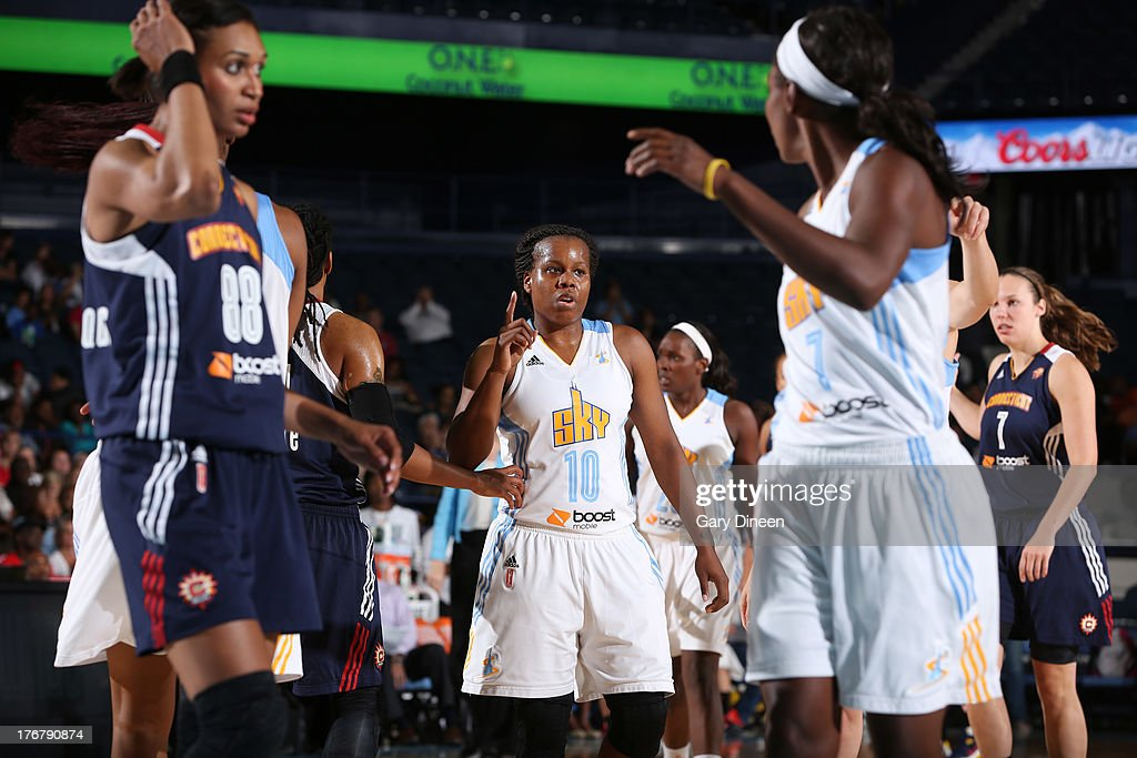 Epiphanny Prince #10 of the Chicago Sky signals to teammate Eshaya Murphy #7 during a break in the action during the game against the Connecticut Sun during the game on August 18, 2013 at the Allstate Arena in Rosemont, Illinois.