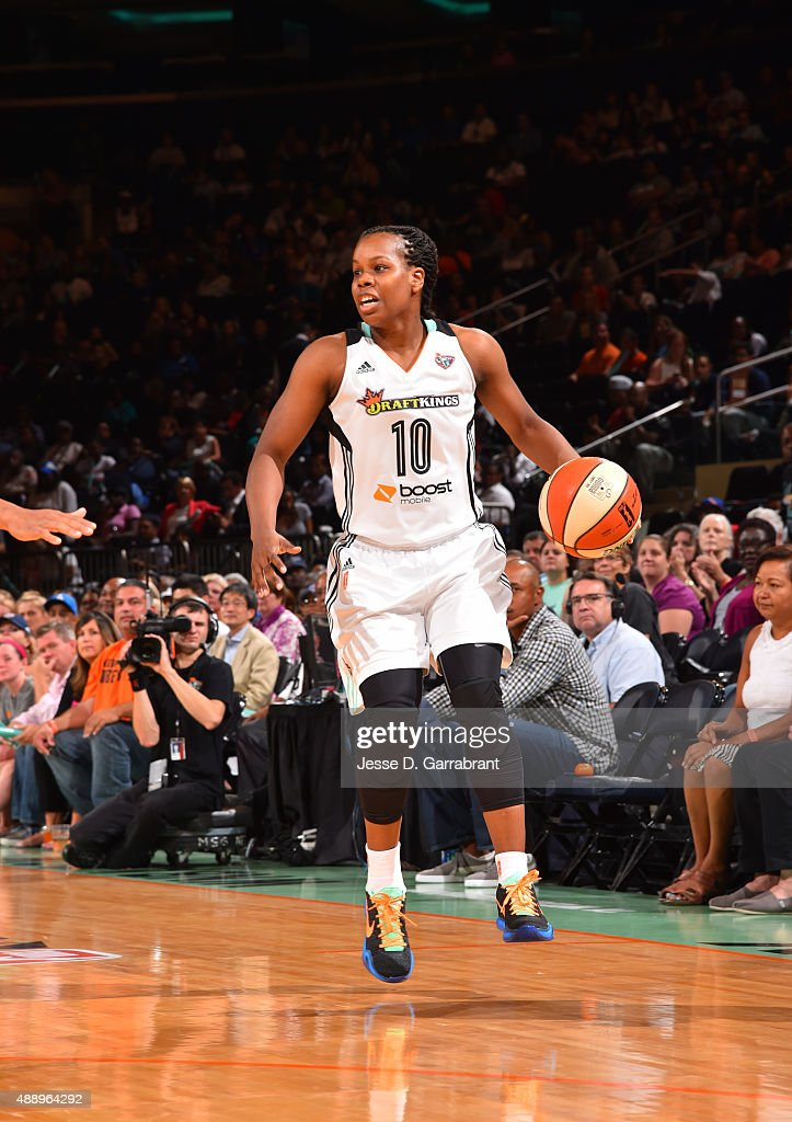 Epiphanny Prince of the New York Liberty dribbles the ball against the Washington Mystics during game One of the WNBA SemiFinals at Madison Square...