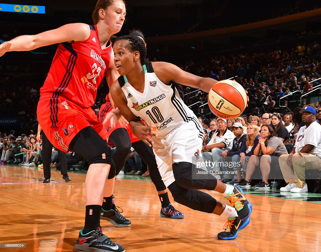 Epiphanny Prince of the New York Liberty dribbles the ball baseline against the Washington Mystics during game One of the WNBA SemiFinals at Madison...