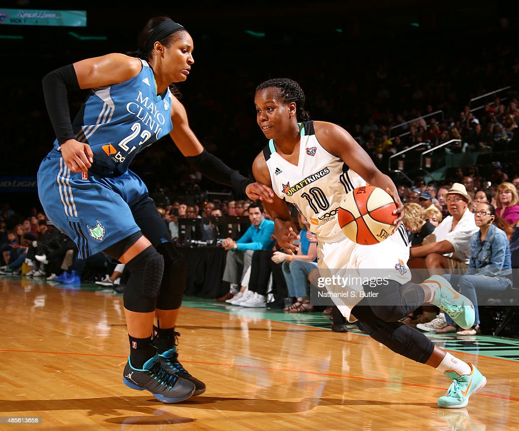 Epiphanny Prince of the New York Liberty drives against Maya Moore of the Minnesota Lynx on August 28 2015 at Madison Square Garden New York City New...