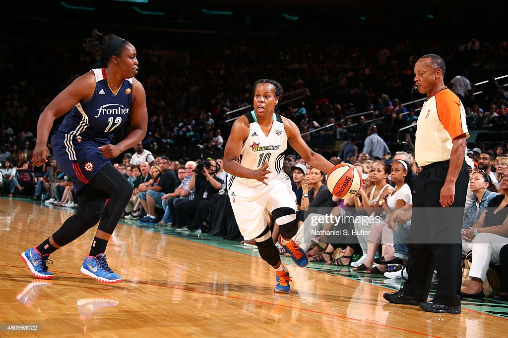 Epiphanny Prince of the New York Liberty drives to the basket against Chelsea Gray of the Connecticut Sun during the game on July 16 2015 at Madison...