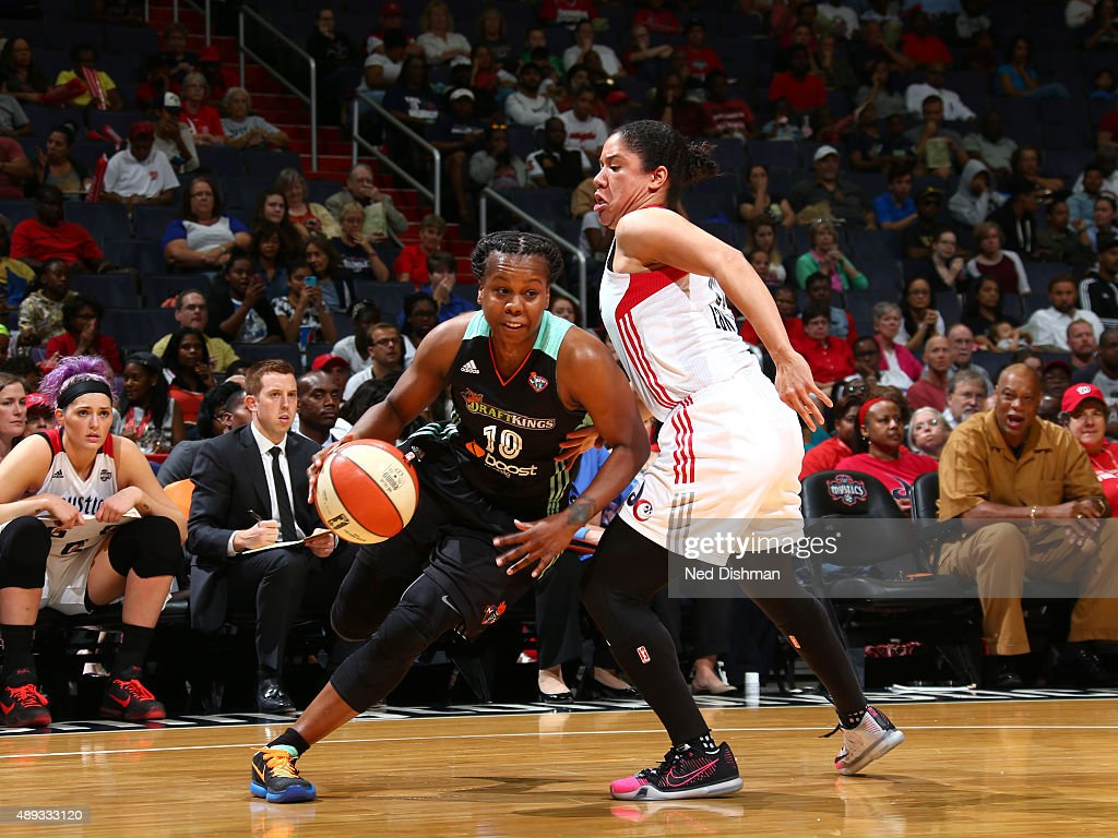 Epiphanny Prince of the New York Liberty handles the ball against Kara Lawson of the Washington Mystics in Game Two of the WNBA Western Conference...