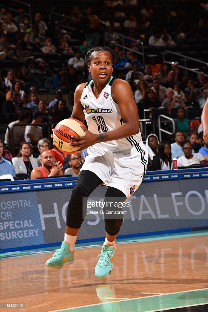Epiphanny Prince of the New York Liberty handles the ball against the Connecticut Sun on September 9 2015 at Madison Square Garden New York City New...
