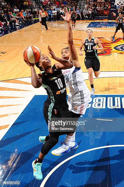 Epiphanny Prince of the New York Liberty shoots the ball against the Connecticut Sun at the Mohegan Sun Arena on August 14 2015 in Uncasville...