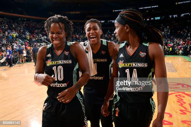 Epiphanny Prince Shavonte Zellous and Sugar Rodgers of the New York Liberty talk to each other after the game against the Minnesota Lynx during the...