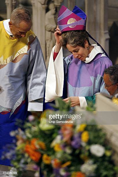 Episcopal Church of the United States Presiding Bishop Katharine Jefferts Schori removes her mitre during her investiture service at the Washington...
