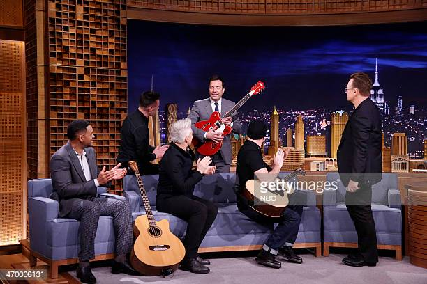 Actor Will Smith Larry Mullen Jr Adam Clayton The Edge and Bono of musical guest U2 during an interview with host Jimmy Fallon on February 17 2014