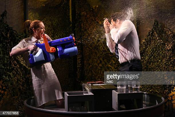 Lindsay Lohan and Jimmy Fallon play Water War on March 6 2014