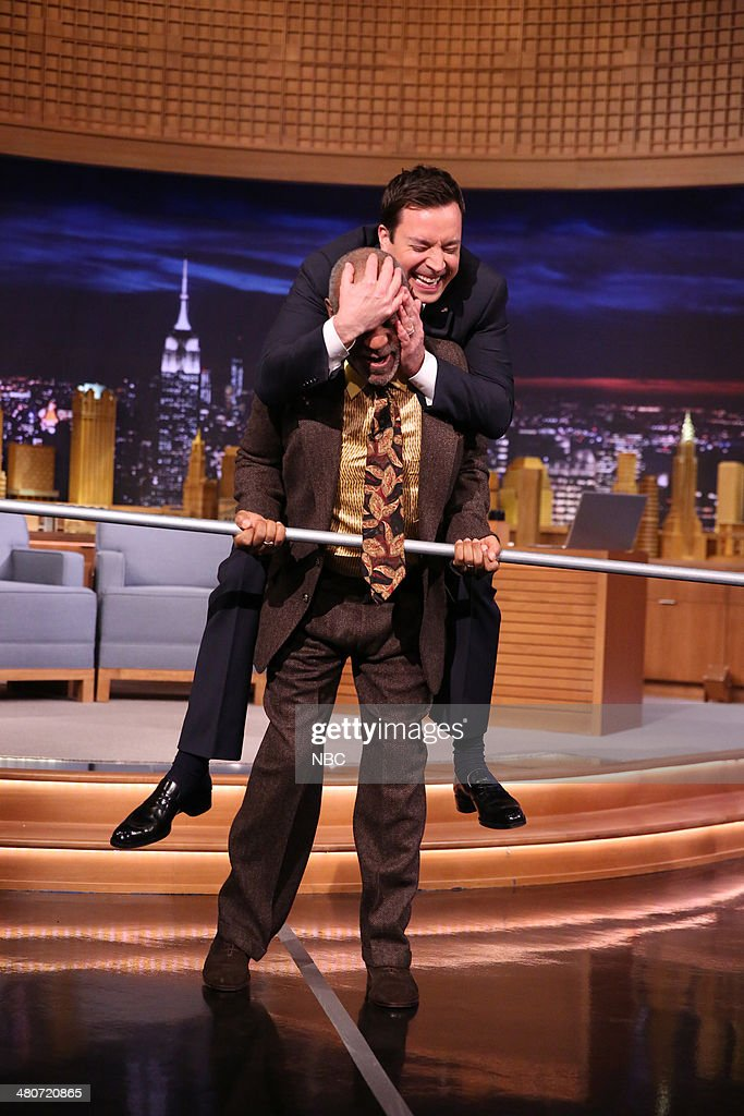Comedian <a gi-track='captionPersonalityLinkClicked' href=/galleries/search?phrase=Bill+Cosby&family=editorial&specificpeople=206281 ng-click='$event.stopPropagation()'>Bill Cosby</a> walks a tightrope with a little help from host Jimmy Fallon on March 26, 2014 --
