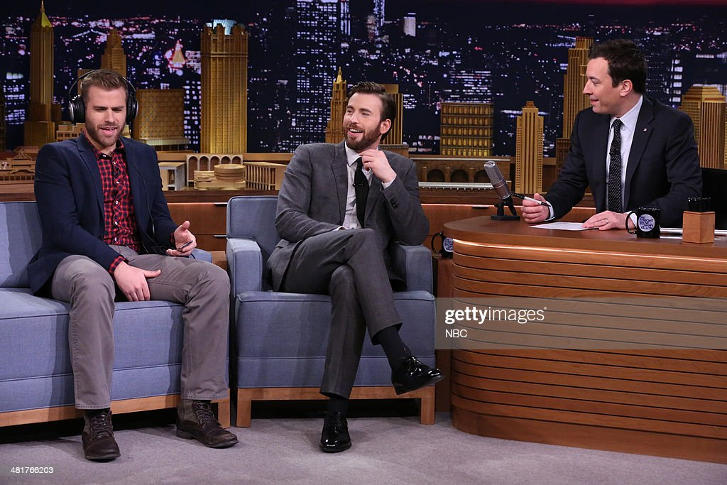 Brothers Scott Evans and actor Chris Evans playing siblingwed game with host Jimmy Fallon on March 31 2014