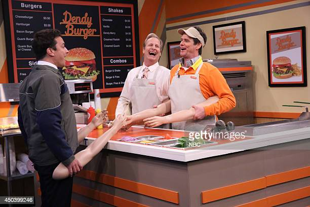 Host Jimmy Fallon actor Jeff Daniels and actor Jim Carrey during the 'Fake Arms Burger Joint' skit on June 10 2014