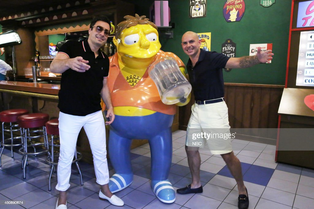 Host Jimmy Fallon and musical artist <a gi-track='captionPersonalityLinkClicked' href=/galleries/search?phrase=Pitbull+-+Rapper&family=editorial&specificpeople=206389 ng-click='$event.stopPropagation()'>Pitbull</a> play 'Giant Duff Beer Pong' on June 19, 2014 --