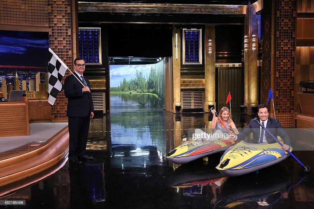 Announcer Steve Higgins looks on as actress Cameron Diaz has a kayak race with host Jimmy Fallon on July 15, 2014 --