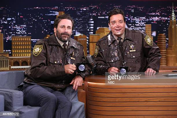 Actor Jon Hamm and host Jimmy Fallon during the 'Palisades Park Pet Patrol' skit on July 25 2014