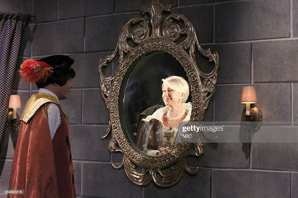 Host Jimmy Fallon and actress <a gi-track='captionPersonalityLinkClicked' href=/galleries/search?phrase=Helen+Mirren&family=editorial&specificpeople=201576 ng-click='$event.stopPropagation()'>Helen Mirren</a> during the 'Mirror Mirror' skit during the 100th episode of the 'Tonight Show Starring Jimmy Fallon? on August 4, 2014 --