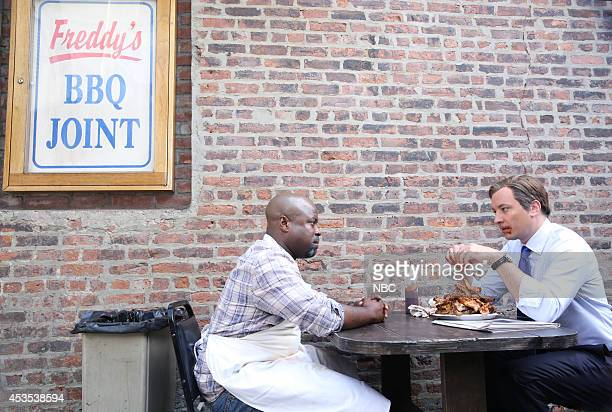Tariq 'Black Thought' Trotter and Jimmy Fallon during the 'House of Cue Cards' skit on August 12 2014
