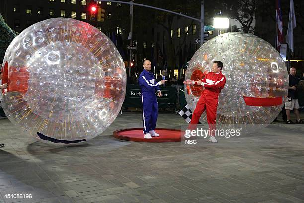 Actor Jason Statham and host Jimmy Fallon compete in a hamster ball race on August 15 2014