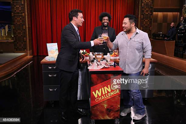 Host Jimmy Fallon and chef David Chang compete in a hot wing eating contest as Ahmir 'Questlove' Thompson watches on August 15 2014