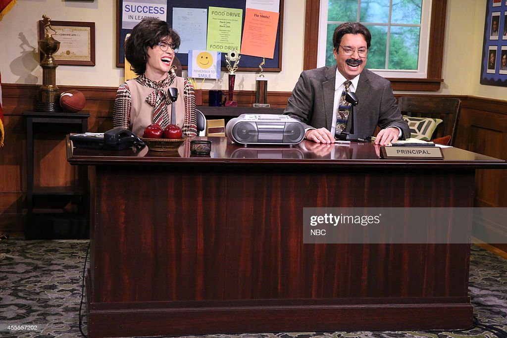 Actress <a gi-track='captionPersonalityLinkClicked' href=/galleries/search?phrase=Julianna+Margulies&family=editorial&specificpeople=208994 ng-click='$event.stopPropagation()'>Julianna Margulies</a> and host Jimmy Fallon during the 'Morning Announcements' skit on September 16, 2014 --