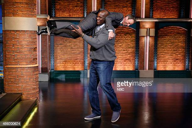 Former basketball player Shaquille O'Neal picks up host Seth Meyers as he arrives on November 18 2014