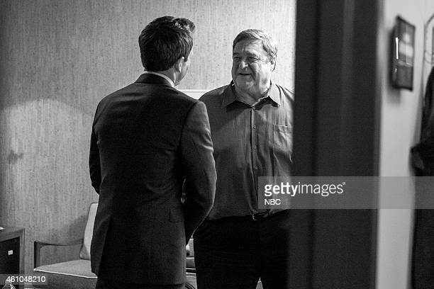 MEYERS Episode 0131 Pictured Host Seth Meyers talks with actor John Goodman backstage on November 24 2014