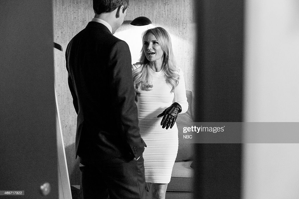 MEYERS -- (EXCLUSIVE COVERAGE) -- Episode 0148 -- Pictured: (l-r) Host Seth Meyers talks with actress Kristin Chenoweth backstage on January 12, 2015 --