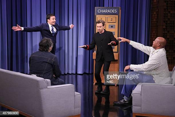 Host Jimmy Fallon musician Jeff Tweedy actor Ewan McGregor and Charles Barkley play charades on October 27 2014