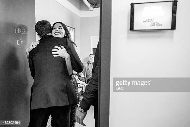 MEYERS Episode 0149 Pictured Host Seth Meyers greets actress Olivia Munn backstage on January 13 2015