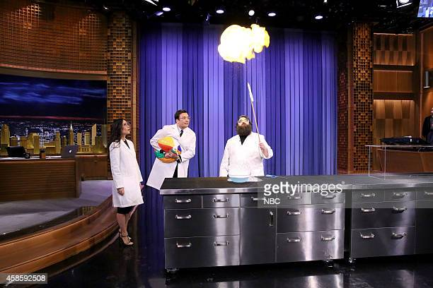 Actress Lucy Liu and host Jimmy Fallon during a science demonstration with Kevin Delaney on November 7 2014
