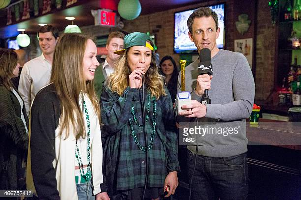 Host Seth Meyers trys out the new Late Night breathalyzer on a partygoer during a St Patricks Day skit on March 18 2015