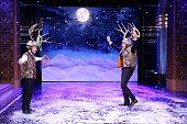 Actor Martin Freeman and host Jimmy Fallon play 'Antler Ring Toss' on December 12 2014
