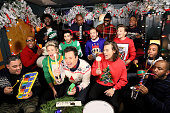 Host Jimmy Fallon and The Roots sing 'Santa Claus is Coming to Town' with One Direction members Niall Horan Zayn Malik Liam Payne Harry Styles and...