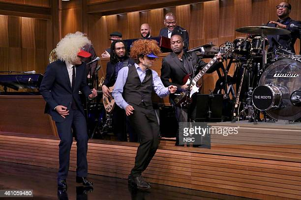 Host Jimmy Fallon and actor Bradley Cooper 'airguitar' on January 5 2015
