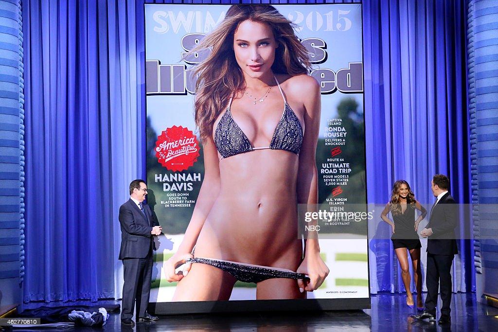 Announcer Steve Higgins model Hannah Davis and host Jimmy Fallon reveal the 2015 Sports Illustrated Swimsuit Issue cover on February 4 2015