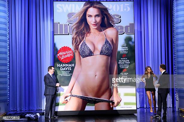 Announcer Steve Higgins model Hannah Davis and host Jimmy Fallon reveal the 2015 Sports Illustrated Swimsuit Issue cover on February 4 2015