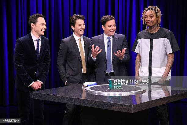 Actor Jim Parsons actor Miles Teller host Jimmy Fallon and musician Wiz Khalifa play Catchphrase on March 16 2015