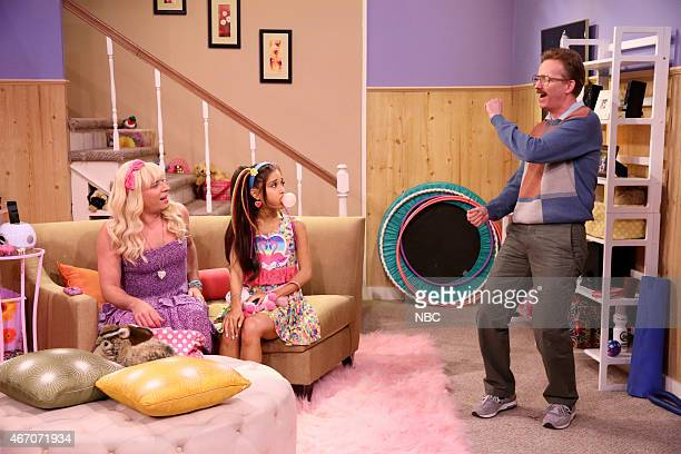 Host Jimmy Fallon singer Ariana Grande and AD Miles during the Ew skit on March 20 2015