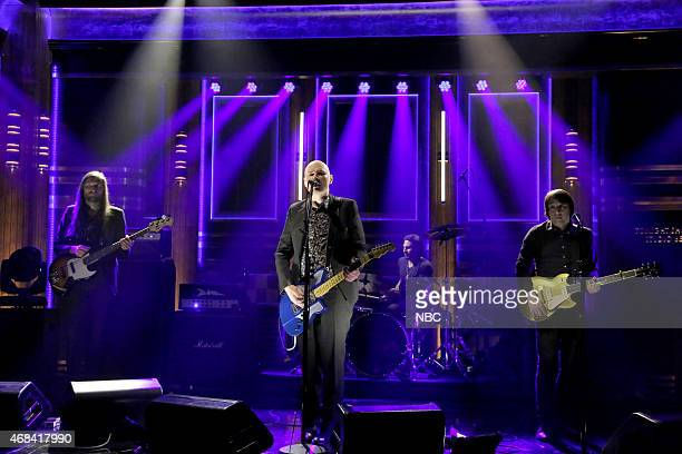 Mark Stoermer Billy Corgan Brad Wilk and Jeff Schroeder of musical guest The Smashing Pumpkins perform on April 2 2015