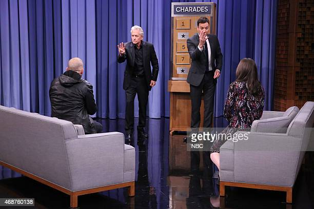 Actor Jon Cryer actor Michael Douglas host Jimmy Fallon and actress Kat Dennings play Charades on April 6 2015