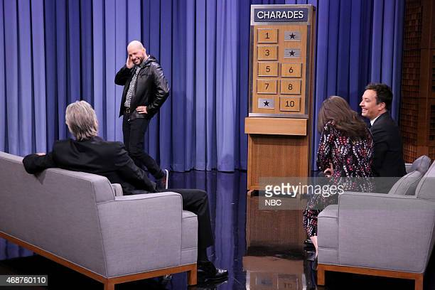 Actor Michael Douglas actor Jon Cryer actress Kat Dennings and host Jimmy Fallon play Charades on April 6 2015