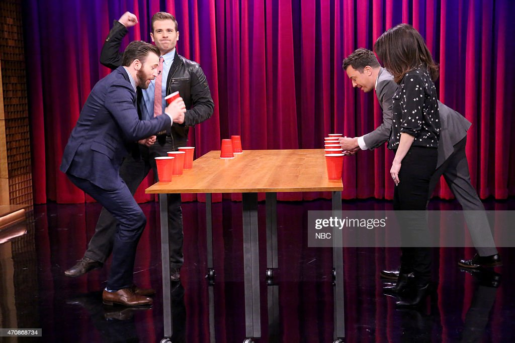 Actor Chris Evans Scott Evans host Jimmy Fallon and Gloria Fallon play Team FlipCup on April 23 2015