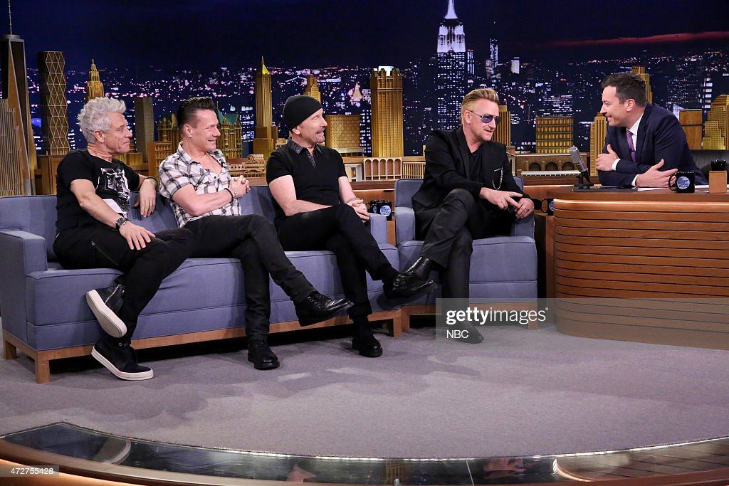 Adam Clayton Larry Mullen Jr The Edge and Bono of musical group U2 during an interview with host Jimmy Fallon on May 8 2015