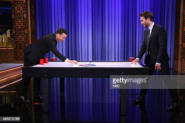 Host Jimmy Fallon and actor Taylor Kitsch play Beer Hockey on August 7 2015