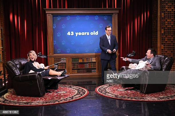 Actress Kaley Cuoco announcer Steve Higgins and host Jimmy Fallon during the 'Pup Quiz' skit on September 17 2015