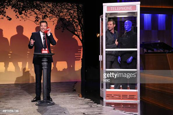 Host Jimmy Fallon Hugh Jackman and a man from The Blue Man Group during the 'Phone Booth' sketch on October 5 2015