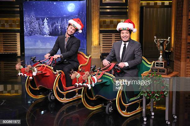 Actor Chris Hemsworth and host Jimmy Fallon during Cooler Scooter Sleigh Race on December 10 2015