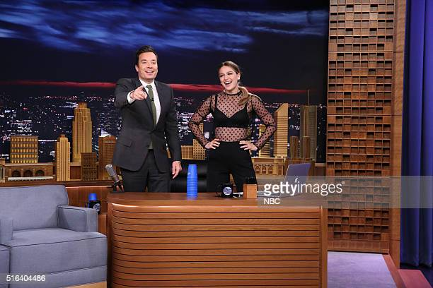 Host Jimmy Fallon and actress Melissa Benoist practice their cup stacking on March 18 2016