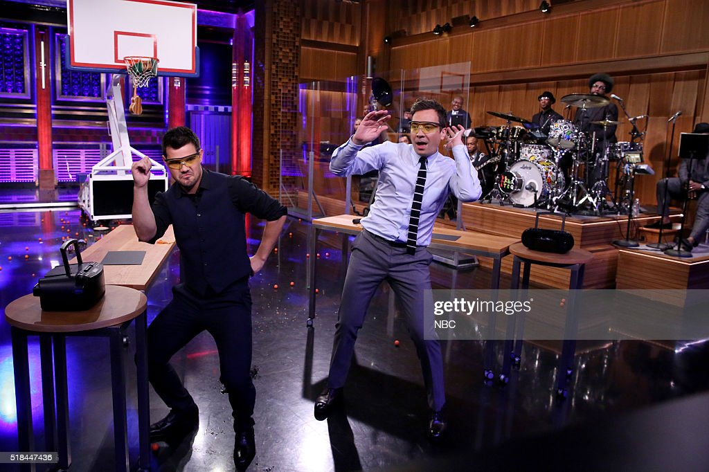 Actor Taylor Lautner and host Jimmy Fallon compete in a Random Object Shootout on March 31 2016